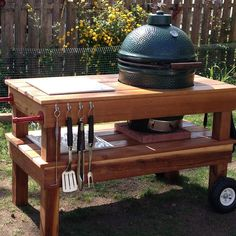 Look what happens when I go out of town. Custom made Big Green Egg Table. Note the plumbing fixture handles. Love!