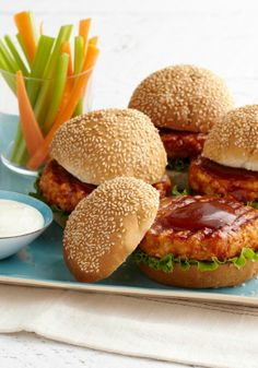 BBQ-Buffalo Chicken Burgers — Chicken patties with BBQ and hot sauces and served with blue cheese dressing—what's not to like about a favorite app turned into a burger?