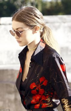 All about the accessories:Drawing more attention to her decolletage, Gigi donned a myriad...