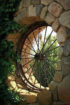 This old wagon wheel became the focal point of this rock wall.