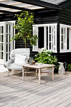 I just like the chair with a quilt over it look for porch furniture rustic cute and can get wet if put quilt away