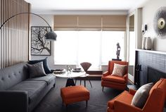 Love the gentle symmetry and especially that fabulous lamp. from Jon Call Designs.