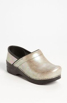 Doubt I'll ever pay $135 for shoes, and these are kind of a middle-aged lady cliche, but I like these. (Dansko Professional - Silver Opal Clog | Nordstrom)
