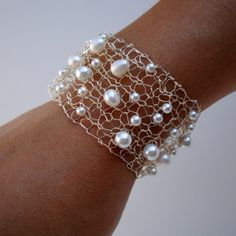 almost 100% certain this is made from crocheting wire and adding pearls along the way. cool - want to try!