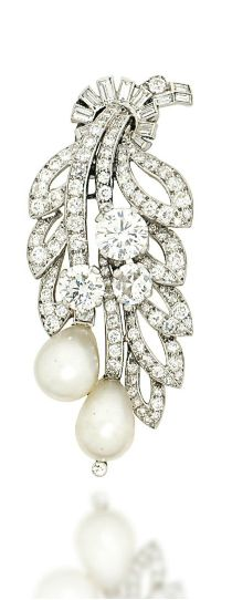 AN ART DECO NATURAL PEARL AND DIAMOND CLIP BROOCH, BY CARTIER Modelled as a foliate spray, the old-cut diamond openwork leaves, to similarly-set flowerheads and natural pearl drop shaped buds, measuring approximately 9.7 x 12 and 9.0 x 12.1mm respectively, with baguette-cut diamond tied ribbon surmount, circa 1935, 6.2cm long Signed Cartier, London