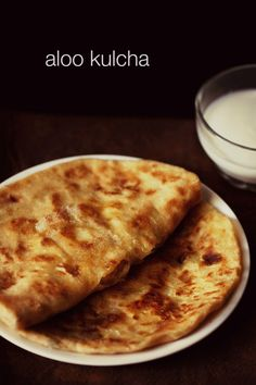 aloo kulcha recipe with step by step pics - sharing one more popular flat bread recipe from north indian cuisine.    aloo kulcha are crisp as well as soft leavened breads stuffed with a spiced potato filling.