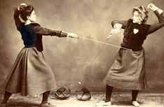 Fencing in Skirts Members of the fencing  team cross foils, 1900