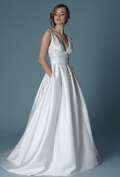 Wedding Dress | Lela Rose. The Versailles is a silk and cotton deep V-neck gown with an embroidered bodice.