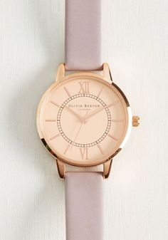 Stay on the track to success with this ever-so-posh Wonderland watch by Olivia Burton. Enhanced with the brand's classic British style, rose gold face and matching roman numerals, and a leather, lilac grey wristband, this shining timepiece earns the highest marks.