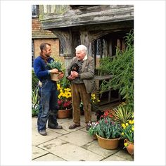 GAP Photos - Garden & Plant Picture Library - Christopher Lloyd and Fergus Garrett outside the front porch at Great Dixter - GAP Photos - Specialising in horticultural photography