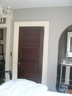 Love the white trim with dark stained doors.I want to paint my trim white this may be a great way to appease my husbandand leave some unpainted wood. - August 17 2019 at Painted Interior Doors, Interior Windows, Interior Trim, Interior Shop, Brown Interior Doors, Interior Walls, Interior Design, Brown Doors, White Doors