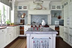 *Great customization. Love the colored tiles between top and bottom cabinets. (@CD - the tiles would be the perfect way to pull the grey from the island into the cabinet space)