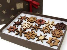 Mini Wooden Snowflake Ornament Gift Box by Timber Green Woods - $27.95   This box of snowflakes makes me happy. I love how they add a natural element to the tree decor. I'd even hang them from my chandelier to add some Christmas cheer to the kitchen.