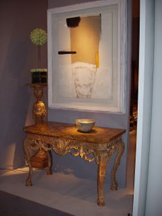Godson & Coles: Painting by Sir Terry Frost over a giltwood side table and with Lucie Rie bowl.