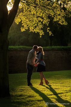 Engaged Couple kissing during a Pre-wedding photoshoot in Holyrood Park in Edinburgh Scotland