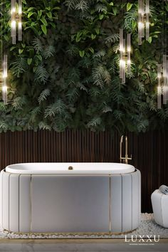 Furthermore, the Darian bathtub was integrated into an enclosed outdoor space that highlights a wall of green foliage. This exclusive bathtub by Maison Valentina features a cluster of gold plated brass, asymmetrical bars enveloping a white leather structure, granting the breezy space an artful and stout personality. #themostexpensivehomes #lifestylebyluxxu #luxxumoderndesignliving #pullcast #blog #luxuryhomes #homestyle #homeinspiration