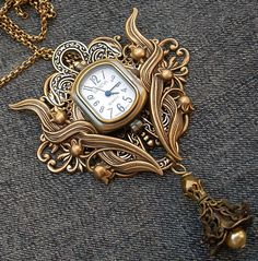 Simply AMAZING!!!! How have I never seen this stuff before!   Steampunk watch necklace or brooch. €75,00, via Etsy.