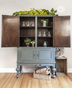 Chalky Patina 'Barn Door' Painted Vintage Cabinet. I added some metallic paint to highlight the detail and the legs and left the interior the original wood stain. Love the finished look! | Salvaged Inspirations