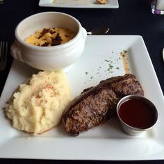My dinner: a nine-ounce sirloin prepared medium rare served with the raspberry bourbon sauce, garlic whipped potatoes, and macaroni and cheese!