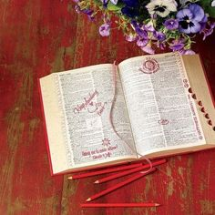 vintage dictionary used as wedding guest book alternative - guests circle a word that describes the couple and leaves a note in the margin