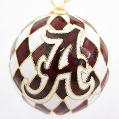 Check out our line of University of Alabama cloisonne ornaments at www.KittyKeller.com - all handcrafted, 24k gold plated, genuine cloisonne.