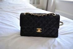 Chanel-this is my favorite. Got one w/out the logo so it's nameless instead of a fake Chanel. Still beautiful!