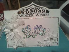 My fisrt card this year using Tonic header die, Spellbinders poinsetta and Sue Wilson Let it Snow, fern and holly dies x