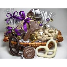 This basket says Good Luck in your new home and is brimming with delicious Enjou Chocolat: assorted chocolates, chocolate covered grahams, milk and dark chocolate nonpareils, chocolate covered Oreo's, Morristown's premiere almond butter crunch, Enjou's very own recipe of hot chocolate, chocolate covered pretzels, gourmet nuts, superb truffles and a chocolate house or key to munch on while unpacking. It's the best! Ingredients and basket or container may vary
