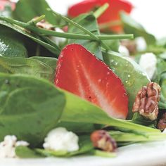 This lively salad captures the essence of early summer with ripe strawberries, chives and baby spinach. To make it a meal, top it with grilled chicken breast.