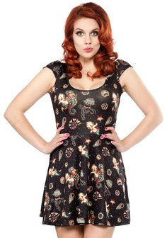 SOURPUSS KEWPIE SEAHORSE SKATER DRESS - Kewpies never looked as adorable as they do when they're riding seahorses! This amazing skater dress features artwork by Stacey Martin-Smith, one of our favorites! You'll be able to wear this dress all year long - and you'll definitely want to once you see how cute it is on you!