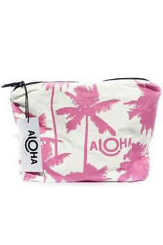 """Whether you go from the beach to the bar or from the pool to the plane Aloha Collection pouches promise to keep your wet stuff separate from your dry stuff. Perfect for your damp bikini board shorts yoga and work-out clothes. Stash your wallet keys cell phone and other valuables and keep them dry!  Measures: 8"""" across x 1.5"""" wide x 6.5"""" tall  Coco Palms Pouch by Aloha Collection. Bags - Beach Ready Montauk The Hamptons New York"""