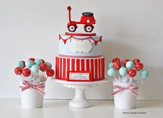 A vespa inspired Christening cake ans cakepops by: minnie's sweet creations