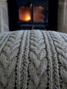 this generous, heavily-textured floor cushion with a great six-stitch cable and lacy pattern between cables along with a simple ribbed buttonband to fasten at the back Knitted Cushions, Knitted Afghans, Knitted Blankets, Knitted Rug, Knitting Patterns, Crochet Patterns, Free Knitting, Knit Pillow, Floor Cushions