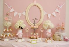 The dessert table at this delicate baby shower was created in a palette of soft pinks for a girlie yet elegant look.