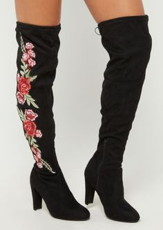 b10d4491efd A pair of faux suede boots featuring a thigh-high design with a faux ...