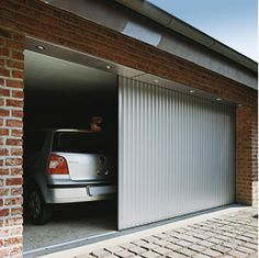 Side roll garage door