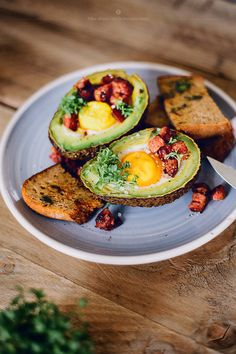 Avocado Baked With An Egg. Without the toast! Great alternative vessel for a Benedict. My runner up, portabela mushrooms.