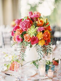 What an amazing floral centerpiece by Wisteria Lane http://wisterialaneflowershop.com/