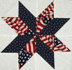 Starflower Quilt Blocks - Patriotic Flag and Star Prints..... I could put a blue spot with my left over stripey fabric