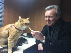 Here's Giles being kind to a cat named Bob. | So, Apparently Giles From Buffy Runs Some Kind Of Animal Rescue Charity