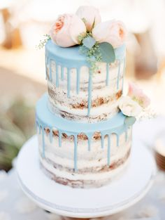 Beverly's Bakery combined two major wedding cake trends for this bride's confection, with a naked-style base and drip accent.