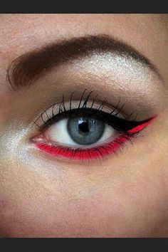 Switch things up with a bright red and black eye liner