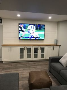 Finishing basement walls Bar Areas is part of Cool Finished Basement Ideas Design Designing Idea - Tv with shiplap Great look to a finished basement 10 ft wide 65 inch tv Ikea narrow cabinets Basement Family Rooms, Basement House, Basement Bedrooms, Basement Bathroom, Basement Furniture, Basement Movie Room, Open Basement, Rustic Basement, Basement Layout