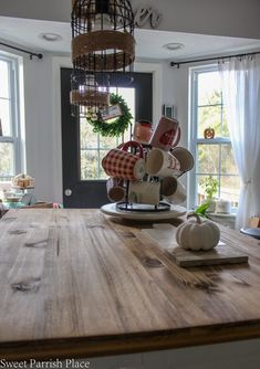 rustic wood kitchen island treated with dark tung oil Kitchen Island Makeover, Wood Kitchen Island, Updated Kitchen, Kitchen Updates, Butcher Block Oil, Tung Oil, Week 5, Dining Room Table, Rustic Wood