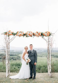 An Elegant Wedding With Rustic Charm | Weddingbells Michelle & Michael beneath their birch arbour adorned with peach roses and white hydrangea.  Flowers by Janie- Calgary Wedding Florist www.flowersbyjanie.com