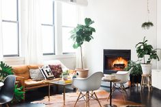 When we first toured this Chicago loft all the way back in 2006, it was the home of Andreas, who had transformed it from a dark, rustic industrial space into a bright, all-white modern home (there are some before photos in Andreas' house tour if you are curious). Wouldn't it be fun to see what the same apartment looks like over ten years later, with someone new making this space their home