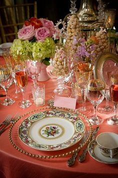 Beautiful coral cloth and lovely flowers - simply lovely table!