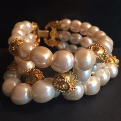 ✨SALE ✨ Vintage Pearl Gold Bead Bracelet Beautiful vintage bracelet of ivory faux pearls and gold beads. Triple strand with a great clasp that stays closed - very well made. Minimal signs of wear on clasp. SALE Jewelry Bracelets