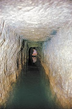 HEZEKIAH'S TUNNEL. For more than a hundred years, an extraordinary water tunnel in Jerusalem has been attributed to King Hezekiah, who dug it to protect the city's water supply during the Assyrian siege of 701 B.C.E. Hence its name, Hezekiah's Tunnel. However, recent scholarly publications now argue that the tunnel was not built by Hezekiah but by his predecessor or his successors. For more, click on the link. Photo: Hershel Shanks.