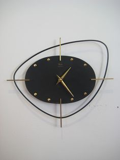 modernize by removing the black outside shape - cool mid-century clock for 21st century. Wall Clock | Ato | 1950s